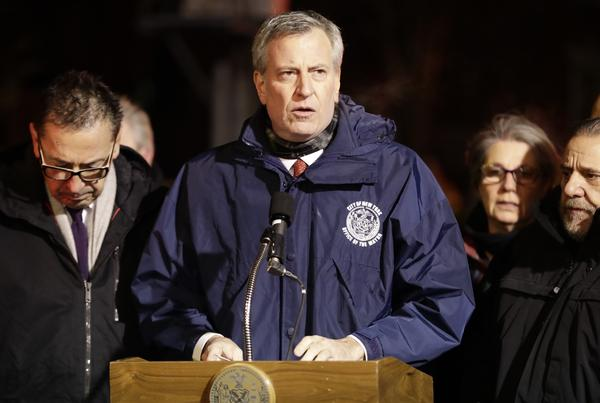New York Mayor Bill de Blasio speaks during a news conference after fire crews responded to a building fire Thursday night.