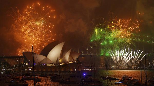 Fireworks explode over Sydney Harbour during New Year's Eve celebrations in Sydney, Australia.