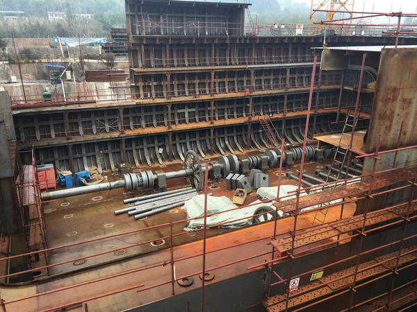 Construction is years behind schedule, but builders have completed the hull of the ship.