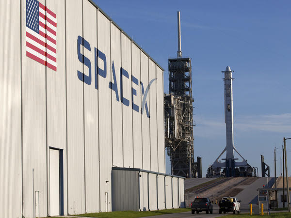 A SpaceX Falcon 9 rocket and Dragon spacecraft await liftoff from the Kennedy Space Center's Launch Complex 39A in Cape Canaveral, Fla., in August.