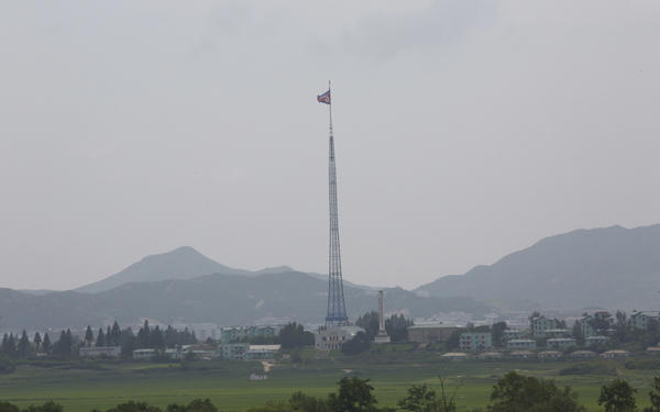A giant North Korean flag flutters from a 528-foot pole near the border with South Korea. Tunnels built by North Korea's military are believed to extend across the border.