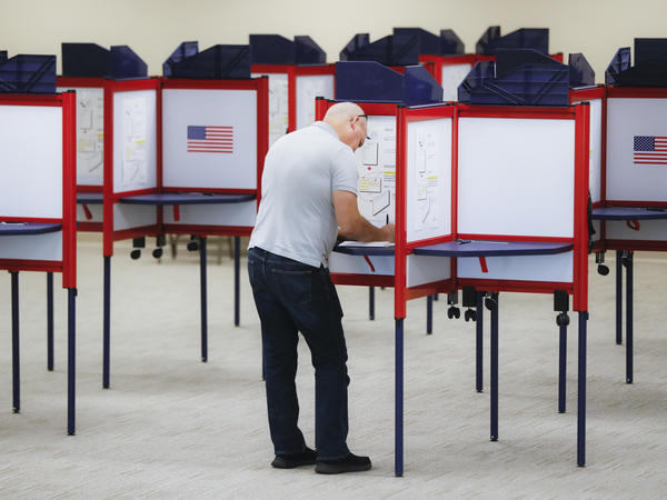 A voter fills out a ballot at the Hamilton County Board of Elections in Cincinnati.