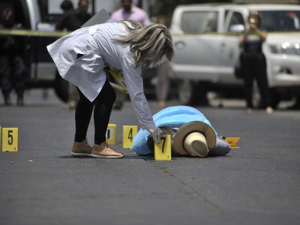 Mexican journalist Javier Valdez lies on the street after he was shot dead in Sinaloa, Mexico, on May 15, 2017. The U.S. State Department is telling Americans to completely avoid five Mexican states because of rising crime and violence.