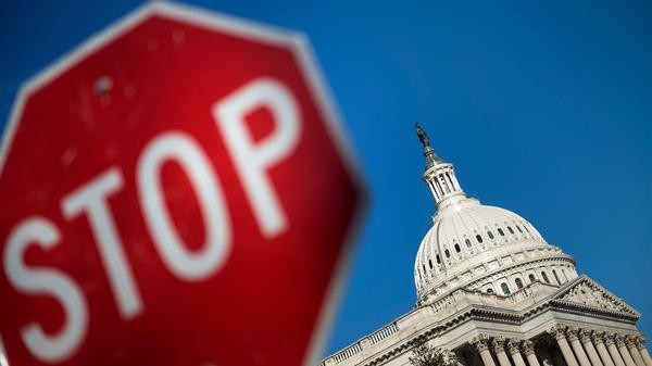 Capitol Hill is seen against a blue sky Saturday, the first day of the partial government shutdown.