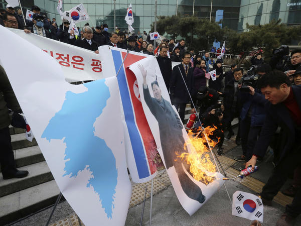 South Korean protesters burn a portrait of North Korean leader Kim Jong Un in front of Seoul Station on Monday.