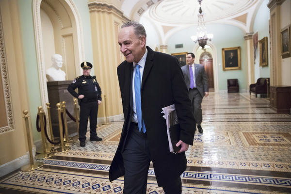 Senate Minority Leader Chuck Schumer, D-N.Y., arrives at the Capitol on Monday, the third day of the government shutdown. With support for a 17-day funding measure, the government is on track to reopen.