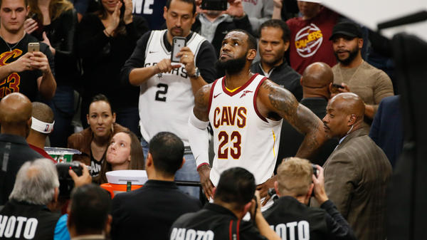Cleveland Cavaliers LeBron James celebrates after scoring his 30,000 career point during a time out against the Spurs at AT&T Center in San Antonio Tuesday night.