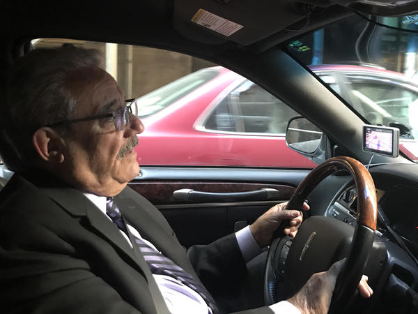 Houchang Golzari drives a Town Car for a service in New York City. He says the Black Car Fund compensated him for some of his lost wages after he was involved in an accident.