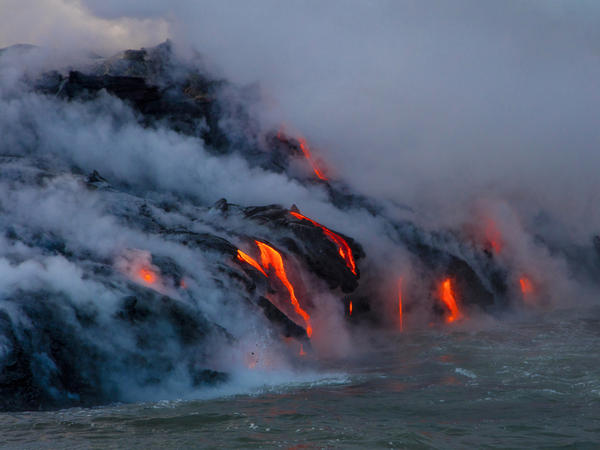What scientists believe to be our oldest ancestor, the single-celled organism named LUCA, likely lived in extreme conditions where magma met water — in a setting similar to this one from Kilauea Volcano in Hawaii Volcanoes National Park.