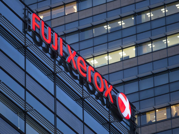 The logo of Fuji Xerox Co., the joint venture between Fujifilm Holdings and Xerox, is displayed outside the company's headquarters in Tokyo.