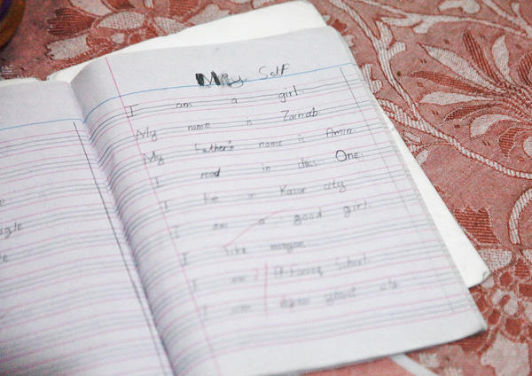 "Zainab's last entry in her English class notebook reads, in part: ""My name is Zainab ... I live in Kasur city. I am a good girl."""