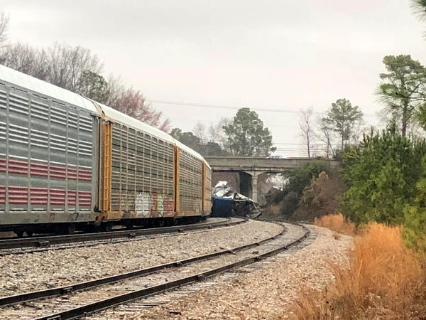 A derailed Amtrak train sits on the track in Cayce, S.C., on Sunday. The Amtrak passenger train slammed into a freight train parked on a side track killing two Amtrak employees and injuring more than 100 people, authorities said.