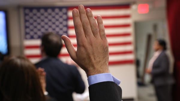 Immigrants take the oath of allegiance to the United States at a naturalization ceremony on Feb. 2 in New York City.