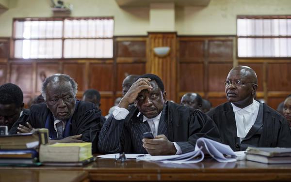 Lawyers for the opposition politician Miguna Miguna wait for a hearing to begin at Kenya's High Court in downtown Nairobi, Kenya on Wednesday.