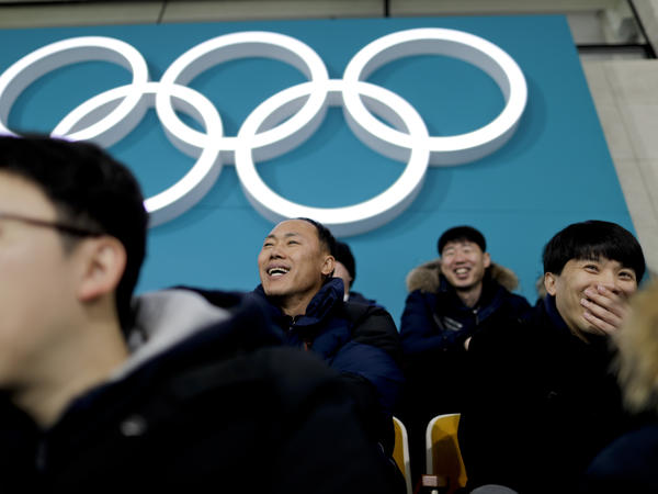 Spectators watch the mixed doubles bronze medal curling match between Russian athletes and Norway at the 2018 Winter Olympics in Gangneung, South Korea, on Tuesday.