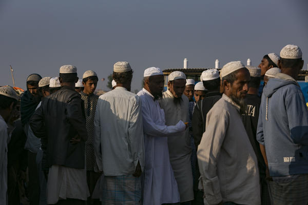 Men congregate after prayers in a makeshift mosque in the Hakimpara refugee camp.