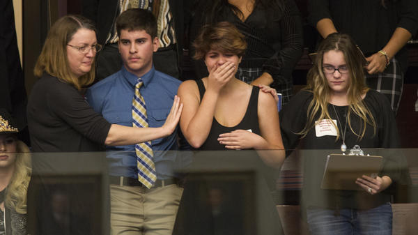 High school students from Parkland, Fla., where a young man gunned down 17 people, react as the state's House of Representatives voted not to hear a bill banning assault rifles.