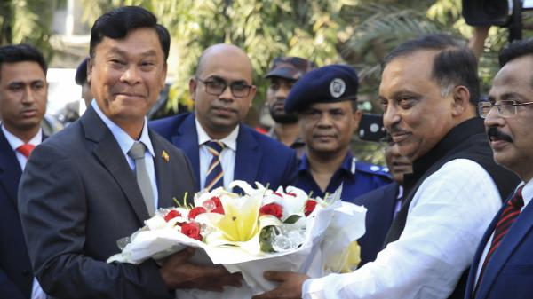 Bangladesh's Home Minister Asaduzzaman Khan (second from right) receives Myanmar's Home Minister Kyaw Swe (second from left) in Dhaka on Feb. 16. A human rights report criticizes Myanmar's treatment of Rohingya Muslims. But in presenting the findings, Amnesty officials called Bangladesh's acceptance of the Rohingya refugees, a rare bright light in a year of worsening human rights violations.
