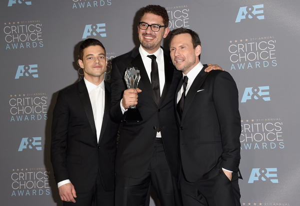"<em>Mr. Robot</em> actor Rami Malek (from left), writer/producer Sam Esmail and actor Christian Slater, at the Critics' Choice Awards in Santa Monica, Calif., in 2016.  ""Their spirit's in exposing these frauds and abuses by people in power,"" Esmail says of hacktivists. ""And that's just something on a human level I respect."""