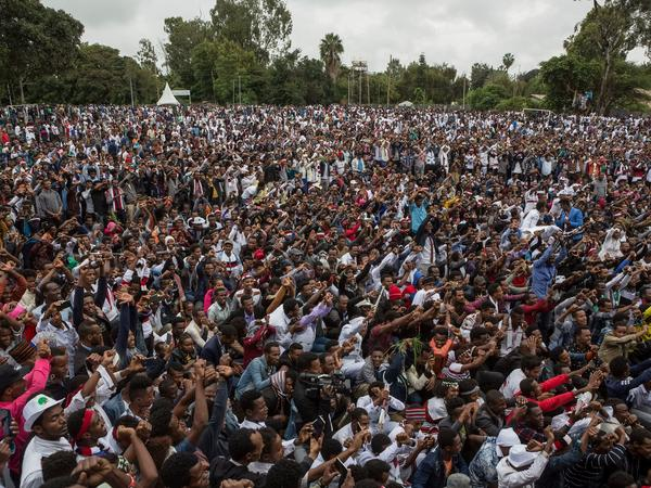 People protest against the Ethiopian government during Irreecha, the annual Oromo festival, in Bishoftu, on Oct. 1, 2017. The Oromos, Ethiopia's largest ethnic group, in late 2015 began anti-government protests over claims of marginalization and unfair land seizures, demonstrations whose focus has since widened to include a host of social problems.
