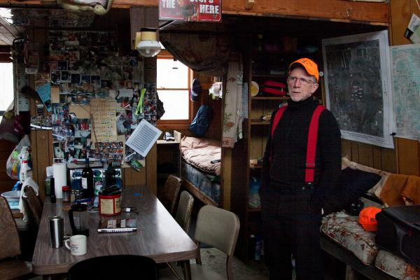 "Tom Wrasse is alone at his hunting shack on the last day of a deer hunting season. ""I try to keep the tradition alive,"" he says."