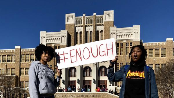 Students hold signs in Little Rock Central's walkout on Wednesday to protest gun violence.