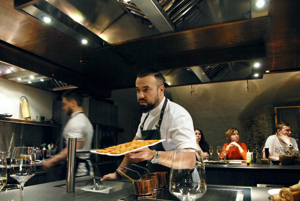 Chef Vladimir Mukhin prepares food at his Chef's Table restaurant in Moscow. Mukhin owns more than 20 restaurants, mostly in Russia, including White Rabbit.