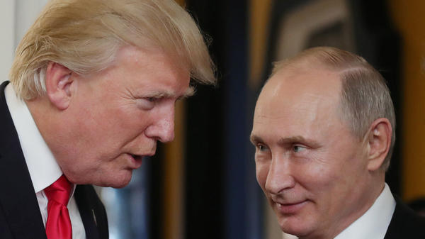 President Donald Trump chats with Russia's President Vladimir Putin as they attend the APEC Economic Leaders' Meeting, part of the Asia-Pacific Economic Cooperation (APEC) leaders' summit in Vietnam on November 11, 2017.