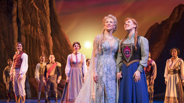 Caissie Levy plays Elsa (left) and Patti Murin plays her sister Anna in the Broadway musical version of <em>Frozen.</em>