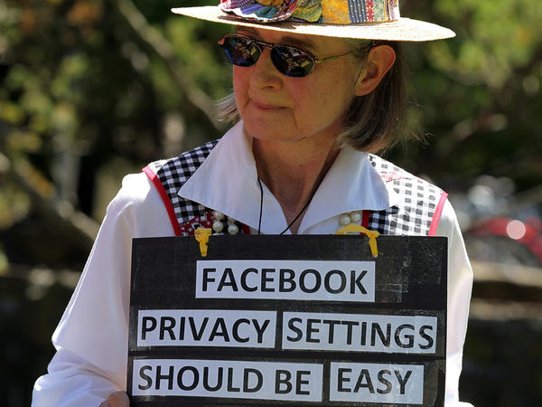 Mary Guedon of the group Raging Grannies holds a sign as she protests in 2010 outside of the Facebook headquarters in California. Privacy advocates say it's too difficult to fully protect your privacy on Facebook.