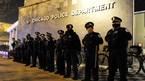 In this Nov. 24, 2015, file photo, Chicago police officers line up outside the District 1 central headquarters in Chicago, during a protest for the fatal police shooting of 17-year-old Laquan McDonald.
