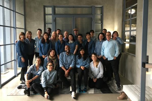 """The NPR West team dressed in Sam's """"uniform"""" in honor of his first day."""