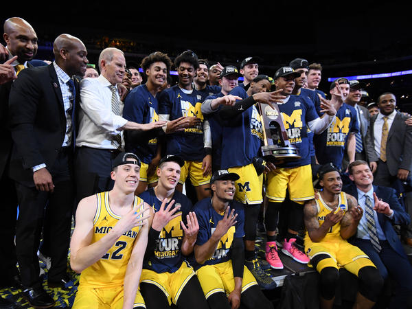 The Michigan Wolverines celebrate after defeating the Florida State Seminoles 58-54 at the Staples Center in Los Angeles on March 24. Coach John Beilein has led the team to 13 straight wins and now the Final Four.