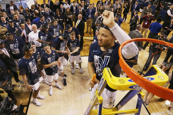 Jalen Brunson of Villanova cuts the net after defeating Texas Tech 71-59 in the East Region to advance to the Final Four.