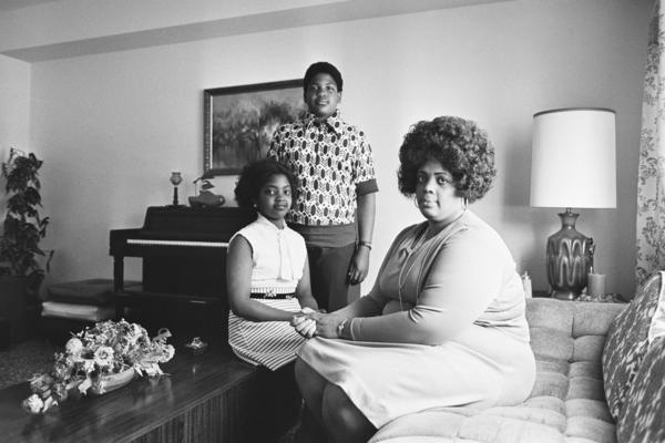 In this April 30, 1974, file photo, Linda Brown, right, and her two children pose for a photo in their home in Topeka, Kan. Brown, the Kansas girl at the center of the 1954 U.S. Supreme Court ruling that struck down racial segregation in schools, died March 25 at age 75.
