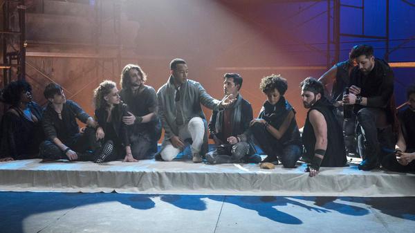 John Legend sits before actors playing the 12 disciples in <em>Jesus Christ Superstar Live.</em>