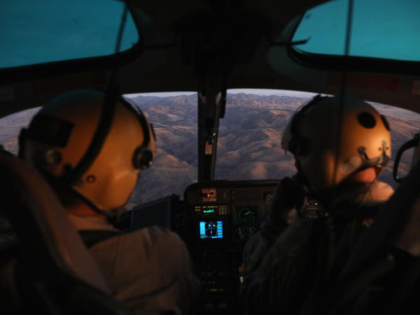 U.S. Customs and Border Protection pilots fly over the Big Bend area of west Texas on November 22, 2017, searching for suspects in the death of U.S. Border Patrol agent Rogelio Martinez.