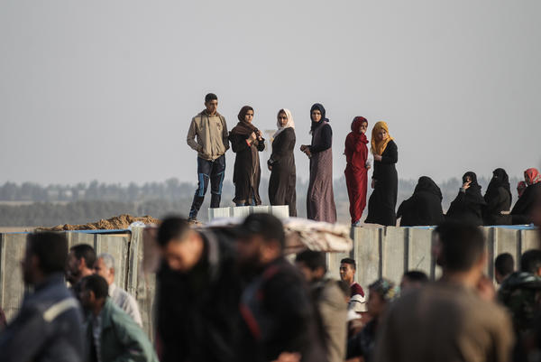 Palestinians stand on a mound at the site of a tent protest in support of Palestinian refugees returning to lands they fled or were expelled from during the 1948 war surrounding Israel's creation, near the border with Israel, in the southern Gaza Strip on Wednesday.
