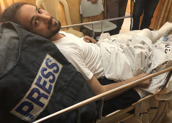"Adham Hajjar, 32, says he was wearing a vest marked ""PRESS"" when he was shot in the leg while covering protests at the Gaza-Israel border on Friday"