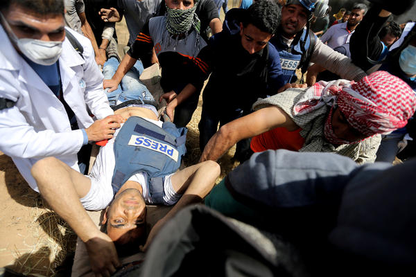 Palestinian journalist Yaser Murtaja, 30, is evacuated after being fatally wounded by Israeli fire while covering the Palestinian demonstrations at the Israel-Gaza border on Friday.