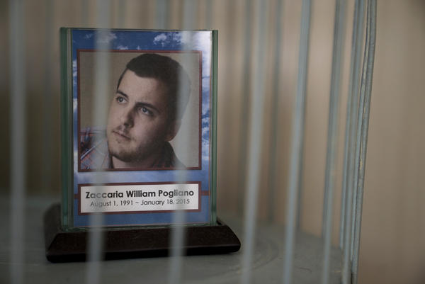 """A framed photo of Laura Pogliano's son Zaccaria. He died in 2015 of heart failure when he was 23. About a year before he died, Laura drove to the hospital to check on Zac, and she found him sitting outside in 40 degree weather in shorts, a hospital gown and no shoes. """"They told me to leave,"""" he told his mom."""