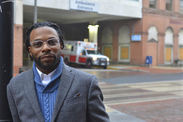 Imamu Baraka, the man who came to the aid of a woman discharged from a hospital wearing only a gown and socks on a cold winter's night, stands outside the University of Maryland Medical Center Midtown Campus in Baltimore. He recorded the events on cellphone video, fearing no one would believe him if he reported a woman being left at a bus stop.