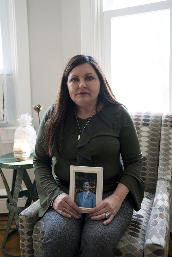 Laura Pogliano holds a photo of her son Zaccaria, who was diagnosed with schizophrenia. As part of his illness, Zac started to think that he had dramatic injuries. He made frequent trips to the emergency room but hospital staff would call her to pick him up.