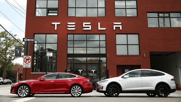 Tesla vehicles sit parked outside of a new Tesla showroom and service center in Red Hook, Brooklyn in 2016.