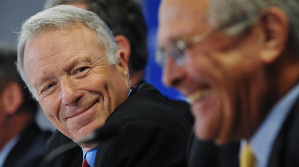 "Lewis ""Scooter"" Libby, former chief of staff to Vice President Dick Cheney, shares a laugh with former Defense Secretary Donald Rumsfeld during a discussion at the conservative Hudson Institute."