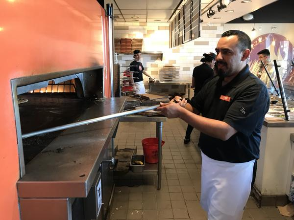 Jimmy Mejia works 50 hours a week as an assistant manager at Blaze Pizza.