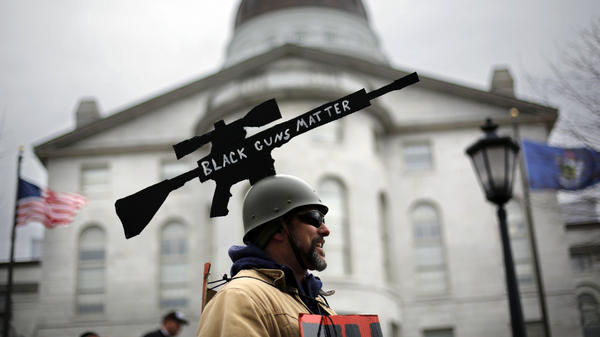 """Joe Dobbins of Hartford, Maine, wore a cut-out of an AR-10 tactical rifle with the words """"Black Guns Matter"""" on it to the gun rights rally in Augusta, Maine on Saturday."""