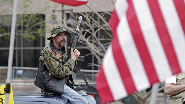 A man participates in the rally in Indianapolis, Ind.