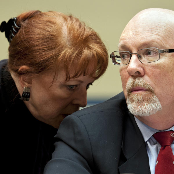Attorney Victoria Toensing confers with her client, Gregory Hicks, former deputy chief of mission in Libya, during congressional testimony on Benghazi in 2013.