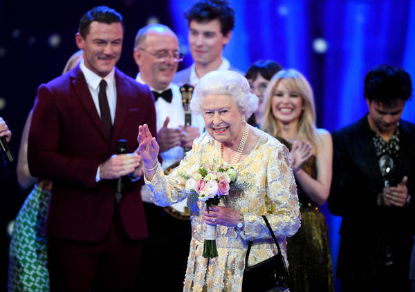 Queen Elizabeth II waves to the audience after a speech from her eldest son Charles, Prince of Wales, at the end of a star-studded concert to celebrate her 92nd birthday at Royal Albert Hall on Saturday.